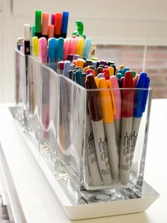marker storage.  Use square vases lined up in a ceramic tray to create a visually pleasing display.