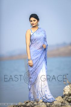 PRICE: INR 9,832.00; USD 148.97 To buy click here: https://www.eastandgrace.com/products/forget-me-not Featuring the Forget-Me-Not balmy blue 100% flat, pure silk chiffon saree, sprayed with shaded Forget-Me-Not florets on white net pleats and blue and silver half-moon handwork on the pallu for a stellar effect. The elegant wavy border is embroidered in silver. For help reach us at care@eastandgrace.com. With love www.eastandgrace.com