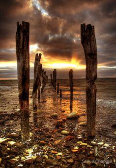 Kangaroo Island Sunrise - eroding jetty lit by a golden sky, Kingscote, Australia by Steve Chapple