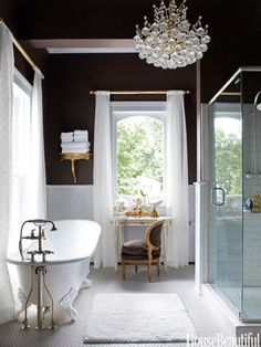 This master bath's chocolaty walls to play up the brilliant whites of a recycled tub.
