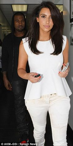 Can we just talk about how Kanye looks like a total stalker in this picture?