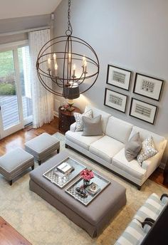 amazing neutral living room design with grey wall and white sofa table chair chandelier and brown rug and glass door and wooden floor - Design Living Room Ideas