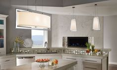 Get a  clean, simple design on a larger scale with this 6 light pendant from the #Arbon collection by Kichler. This pendant highlights the modern features brought to life in Polished Chrome. Topped off perfectly with just the right white fabric shades.