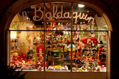 Baldaquin - Canopy::Toys Toys Toys at Christmas. A festive shop window beckons w/gifts for kids of all ages.