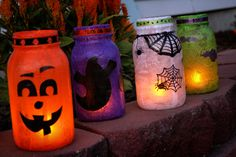 Halloween Lanterns.   I made these using empty jars, tissue paper, Modge Podge, and hand-cut construction paper decorations.