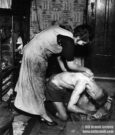 Bill Brandt Great Britain (England) century Coal-miner's Bath, Chester le Street, Durham, c. 1937 Gelatin-silver print, printed late x in. Cantor Center accession no.