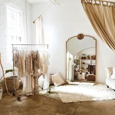 This space is minimally regal due to the gold and brown tones against the stark white.