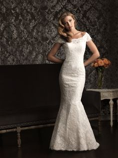 Allure Bridals: Style: 9000--Soft and romantic. This slim, fitted gown features a delicate lace throughout. The scooped neckline features an off-the-shoulder cap sleeve with a v-shaped back.