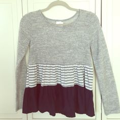 Baby doll sweater size s Gray, navy blue, white adorable sweater! Bought from a boutique. Flutters out at bottom very cute fit. Not free people. The brand wasn't an option (Primi) Free People Sweaters