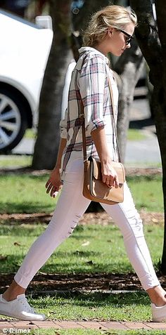 Rock 'n' roll: She rolled up the sleeves to her shirt while adding a pair of white sneaker...
