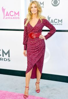 Faith Hill in a burgundy Michael Kors Collection dress, cinched at the waist with a matching belt, and finished with Neil J. Rodgers sandals.