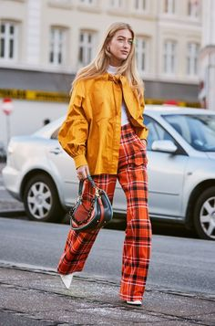 Copenhagen fashion week street style January orange checked trousers worn with a yellow jacket All of the coolest looks and trends coming out of Copenhagen's street style from the current Fashion Week. Get some Danish fashion inspo right here. Street Style Trends, Street Style Fashion Week, Street Style Outfits, Look Street Style, Spring Street Style, Mode Outfits, Look Fashion, Autumn Fashion, Womens Fashion