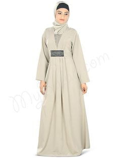 Beautiful Bead Work Embroidered Warm Grey Party Wear Abaya | MyBatua.com Nashitah Abaya! Style No : AY-329 Shopping Link : http://www.mybatua.com/nashitah-abaya Available Sizes XS to 7XL (size chart: http://www.mybatua.com/size-chart/#ABAYA/JILBAB • Pleats around neck line with embroidery patch in center • Embroidered patch at waist with pleats • Straight sleeves • Utility pockets on both sides
