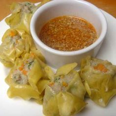 Chinese Dumpling Recipe Appetizers with pork shoulder, shrimp, scallions, cilantro, fish sauce, salt, corn starch, large eggs, sesame oil, water chestnuts, fresh ginger, won ton wrappers