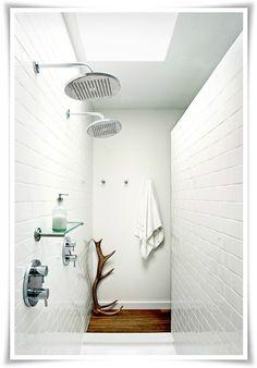White tiles, wooden floor, two shower heads <3