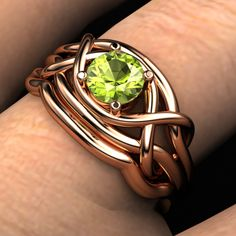 Infinity Knot Ring in rose gold with peridot, and matching band
