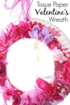 A pretty paper plate Valentine's wreath for toddlers and preschoolers to make. Painting, gluing, crumpling... great fine-motor craft for home or preschool. #craftpaper