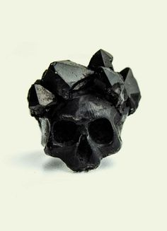 BLACK SKULL WITH CRYSTAL CROWN: Macabre mood of subjects is embodied by cutting-edge materials. For the production of accessories the polymer plastic is used because of the exceptional strength and durability of the material, it is usually used in heavy industry. Part of the rings are encrusted with tin and semi-precious stones.