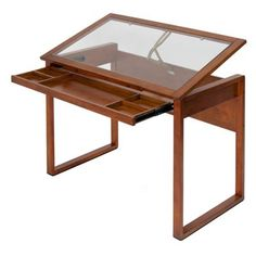 Have to have it. Studio Designs Ponderosa Glass Topped Drafting Table $182. Another furniture-quality drafting table that could easily be both drawing and writing desk. Add height adjustability and it could be even better, and the glass top can serve as a picture (attached underneath) framing easel or table top when not in work use.