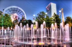 Fountains in Centennial Olympic Park in Atlanta with the back drop of Sky View ferris wheel