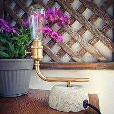 Table lamp made from found pieces and white concrete