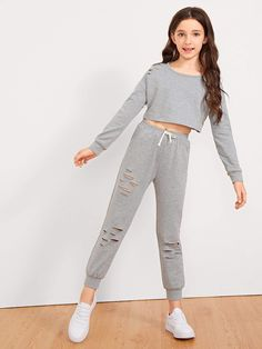 Shop Girls Cut Out Front Top & Drawstring Waist Pants Set online. SHEIN offers Girls Cut Out Front Top & Drawstring Waist Pants Set & more to fit your fashionable needs. Teenage Girl Outfits, Crop Top Outfits, Kids Outfits Girls, Girls Fashion Clothes, Tween Fashion, Cute Outfits For Kids, Teen Fashion Outfits, Cute Casual Outfits, Cute Clothes For Kids