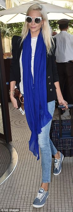 Pop of colour: Having dressed comfortably for her flight, the sister of supermodel Cara, added a splash of colour to her look with a bright purple scarf