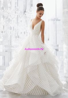 Light and Airy, this Stunning Flounced Organza Ball Gown with Wide Horsehair Edging Features a Plunging V-Neck and Open V-Back. Illusion Insets Along Sides . Av