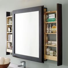 Bath mirror with pull-out by Decorá, from $1,660  Cabinets glide out from either end to give this framed mirror unit dual function. It comes in 24- or 30-inch-wide models and a range of wood finishes.