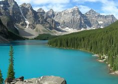 Moraine Lake in Banff National Park, Alberta, Canada. Glacially-fed; shade of blue at river's crest in late June due to rock flour suspended in water.