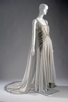 Vionnet Smoke-gray chiffon, rhinestones and silver beads. Worn by Mrs. Potter Palmer II when she was presented to the Queen of England in 1938.