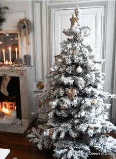 love the snow covered christmas tree with burlap ornaments