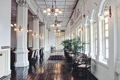 An airy corridor at Raffles Hotel