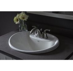 Kohler K-2839-1 - cast iron, love shape it can do wide but I think the handles would go over edge and look weird