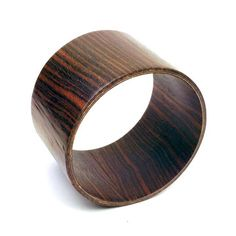Ebony Bangle by Tivi   Made of laminated ebony veneers, this earthy accessory brings a jungle warrior vibe to your look—without overdoing it. Clean, simple and streamlined, Tivi's pieces are a big hit with celebrities such as Victoria Beckham and Jennifer Garner.