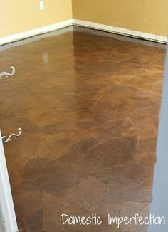 Faux-leather floor covering made from brown paper bags, Elmer's glue, stain and polyurethane. Photo tutorial.