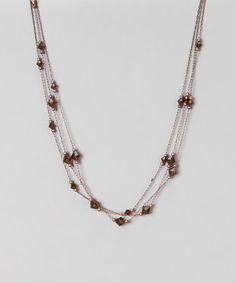 Take a look at this Copper & Smoke Topaz Lantern Triple-Strand Necklace by 1928 Jewelry Company on #zulily today!
