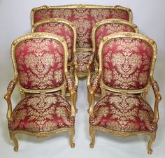 A Very Fine and Palatial French 19th Century Louis XV Style Gilt-Wood Carved Five Piece Salon Suite, comprising of a canapé (Settee) and four fauteuils à la reine (Armchairs), all of grand size, high backs and recently re-upholstered. Circa: Paris, 1880.