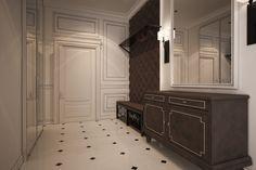 Интерьер прихожей в минималистичном стиле выполнен в белоснежно-шоколадных тонах. Мебель темного цвета выграшно контрастирует на фоне белоснежных стен и     пола. Освещение выполнено поточечное, многоуровневое. При входе открытая вешалка для верхней одежды с тумбой для сиденья и сумок, выполнена на заказ.