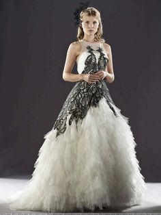 """French designer, Jany Temime, said that """"Fleur's dress was made in organza and decorated with a pair of phoenixes that face each other on the bodice and form the silhouette of a heart. I chose the phoenix because, like love, it is eternal."""""""