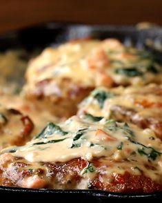 Creamy Tuscan Chicken - droooool this looks so good. pan fried skin-on bone-in chicken with creamy parmesean tuscan sauce