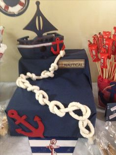 Table display made from boxes, fabric, painted anchors and boat....Nautical theme!