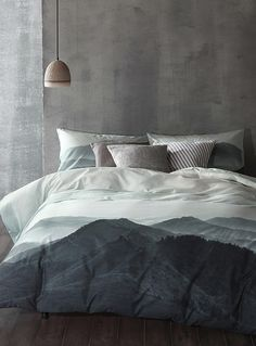 Cloth & Clay collection at Simons Maison. Nyoka Duvet Cover Set - Captured at daybreak and inspired by the poetic beauty of mountain ranges, this photo evokes a feeling of calm and serenity. A piece that will infuse minimalist decors with a touch of style.