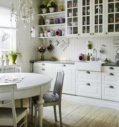 Love the mix of open shelving with glass door shelving & whitewashed floors.  I live for farmhouse sinks.