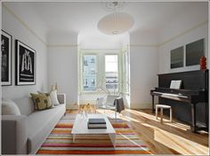Image result for small white room with wall piano