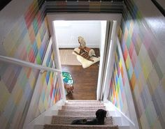 Dress up the walls by the stairs with colorful paint chips.  Source: Cozy Little Cave