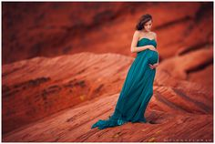 POSE _ gorgeous soft hands. Lisa Holloway of LJHolloway Photography photographs gorgeous pregnant woman in the Valley of Fire on the red rocks wearing long teal gown