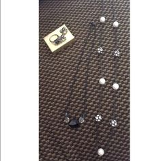 A jewelry set ! It have 2 necklaces , a super cute size seven ring and some diamond studded bow earrings. PLEASENO TRADES OR PAYPAL I will not respond to comment offers . Thank you  Jewelry