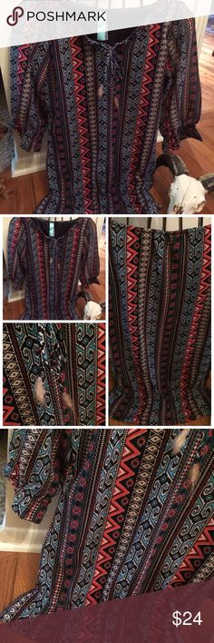 "🔺Boho Aztec Print Elbow Length Sleeve Top  🔻 NWOT! 🔺This top is a beautiful Aztec/Boho Print! The colors are gorgeous w/ a black & brown background, also features different aztec prints in turquoise, burnt orange 🔶and cream. Neckline has a tie in the center with crimped feathers & beads. Sleeves have elastic around elbow area, also elastic around a dropped waist. It is also fully lined, in the body of the top, just not the sleeves. Measures 17 1/2"" across bust & 27"" L. . 95% polyester-5%…"