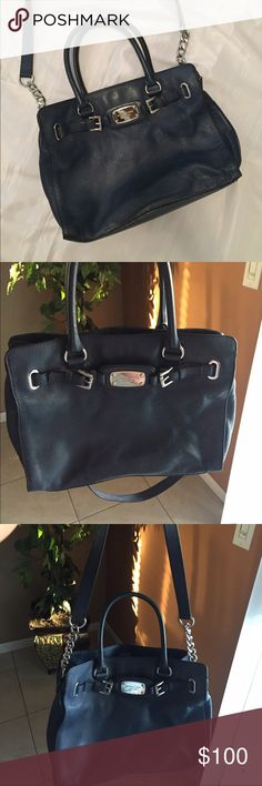 Used Michael Kors purse Navy blue purse, inside needs to be clean. Very spacious and sturdy will last forever Michael Kors Bags